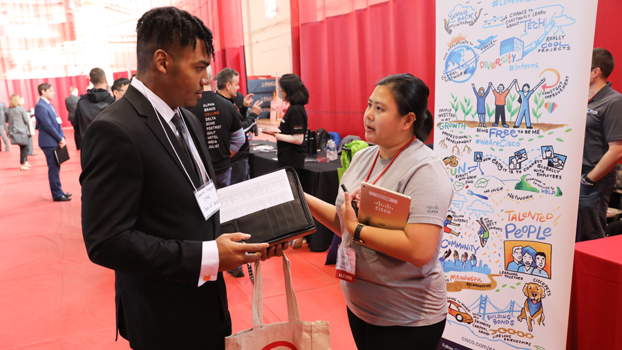 Representative from Cisco systems speaks with RPI student at the Career Fair
